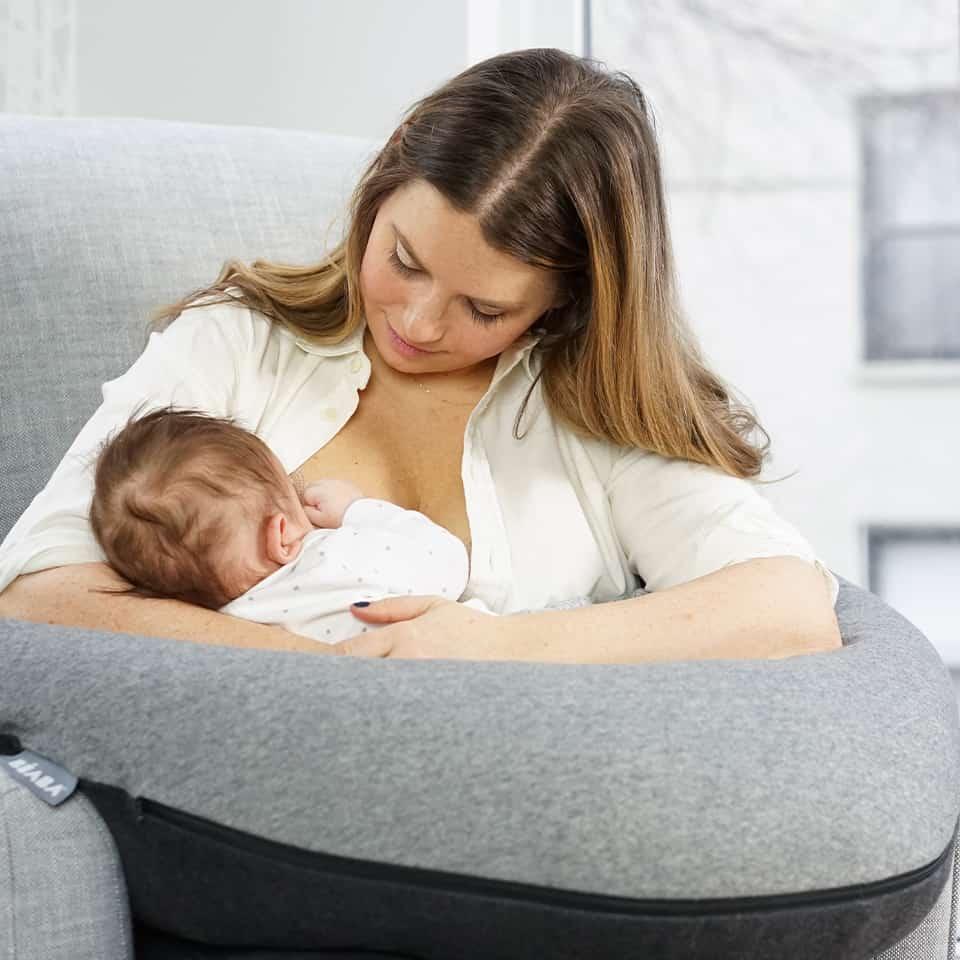 Mom breastfeeding baby on Big Flopsy in Charcoal