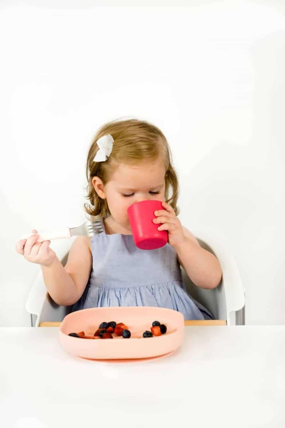 Toddler Drinking From Beaba Silicone Cup Berry