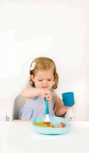 Toddler Drinking From Beaba Silicone Cup Peacock