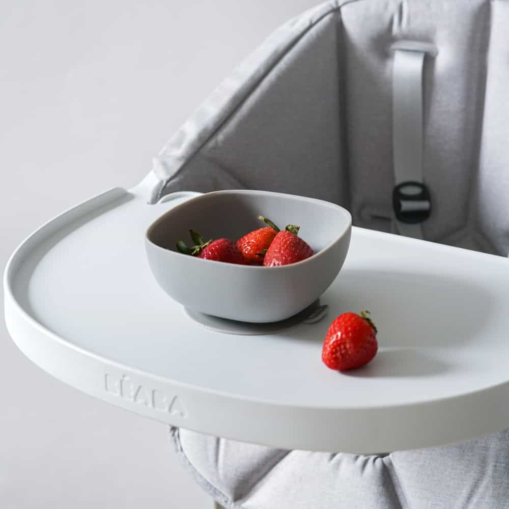 Beaba silicone bowl with strawberries in it