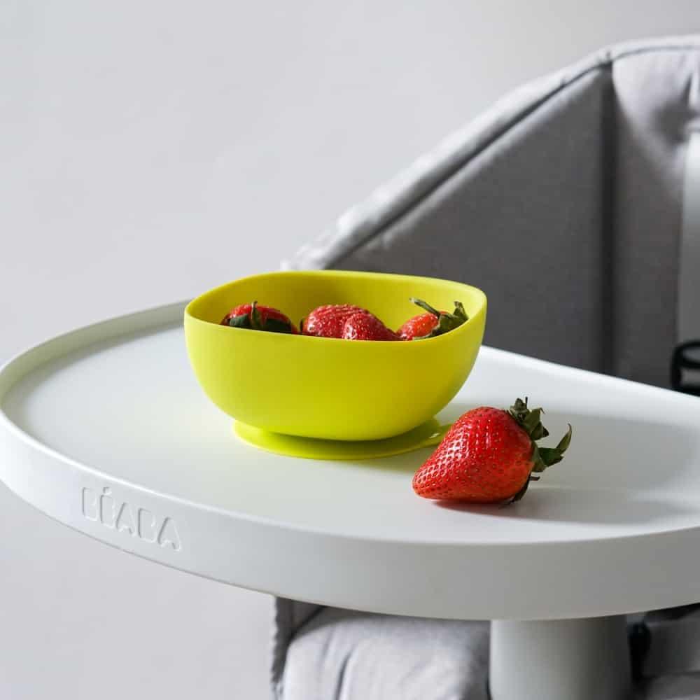 Beaba silicone spoon next to berries