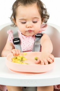 Toddler eating with silicone suction plate rose