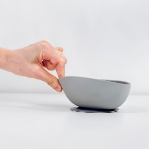 Hand tugging on silicon suction bowl cloud