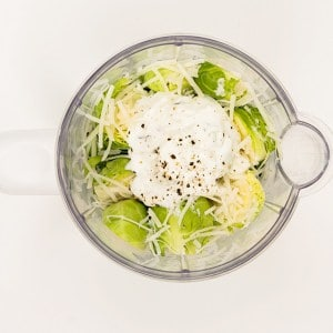 creamy brussel sprouts with parmesan in mixing bowl