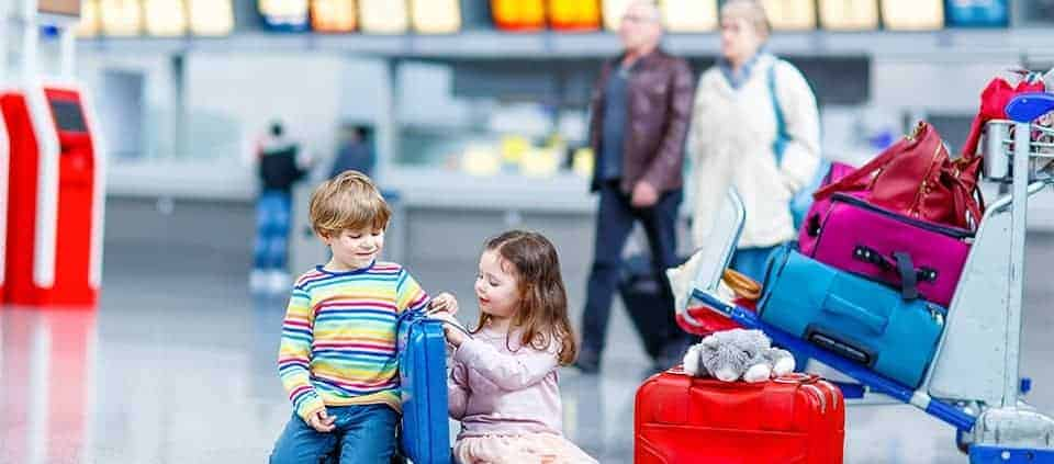 kids sitting on floor in airport