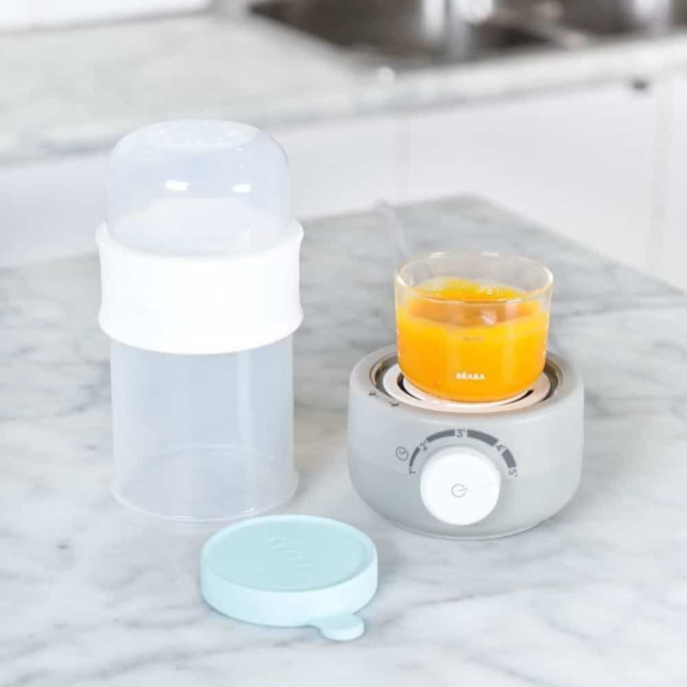 Glass Silicone Container with Frozen Squash Puree Defrosting in Babymilk Cloud