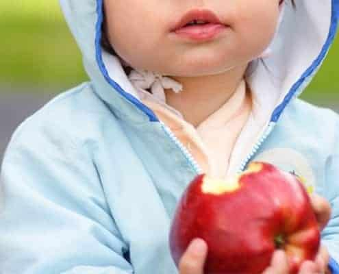 kid eating an apple