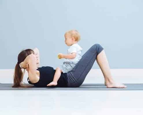 Mom Doing Sit. Ups with Toddler on Lap