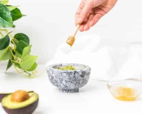 Putting honey into bowl