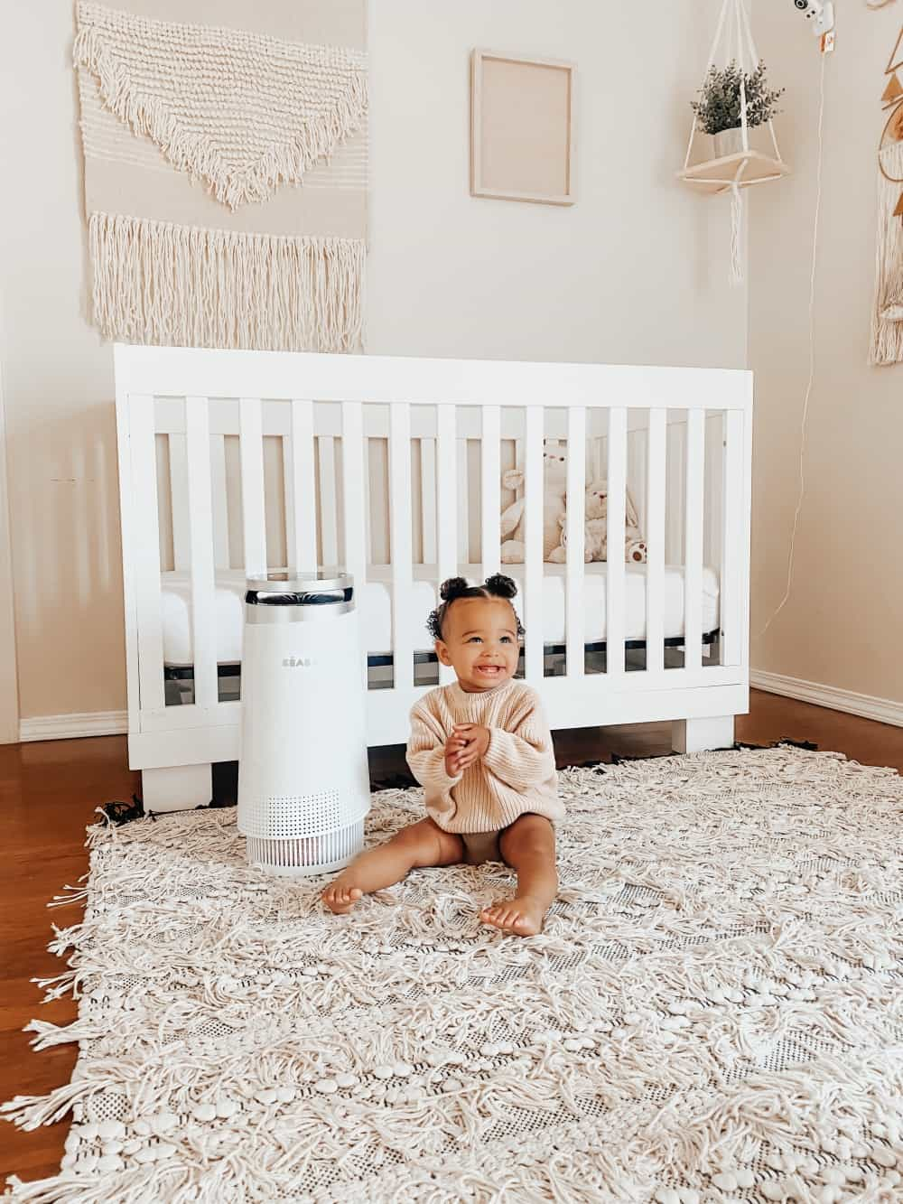 Air Purifier in Nursery Room with Toddler Next to It