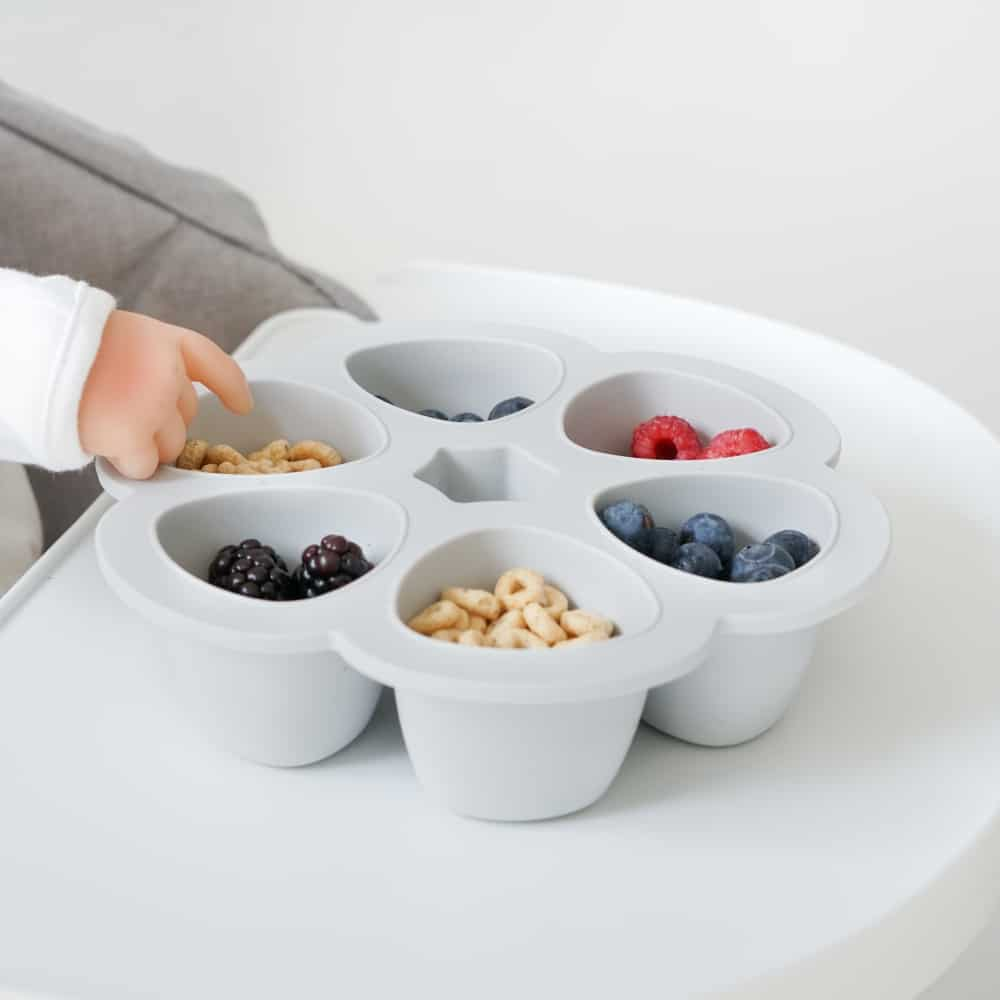 Beaba multiportions in cloud, baby reaching fruits and cereal in portions
