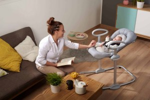 Mom playing with baby in Beaba Up & Down High Chair