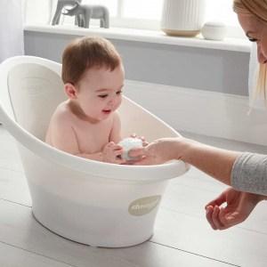 Baby playing in Beaba by Shnuggle Baby bath in grey