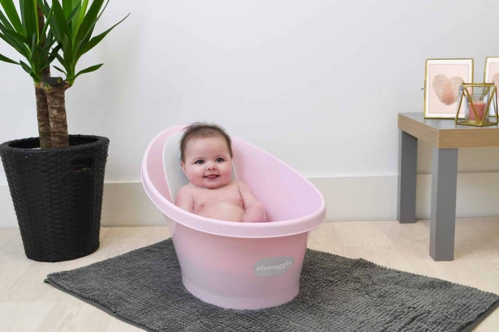 Baby sitting in Beaba by Shnuggle Bath Rose