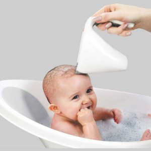 baby in bath with washy cup