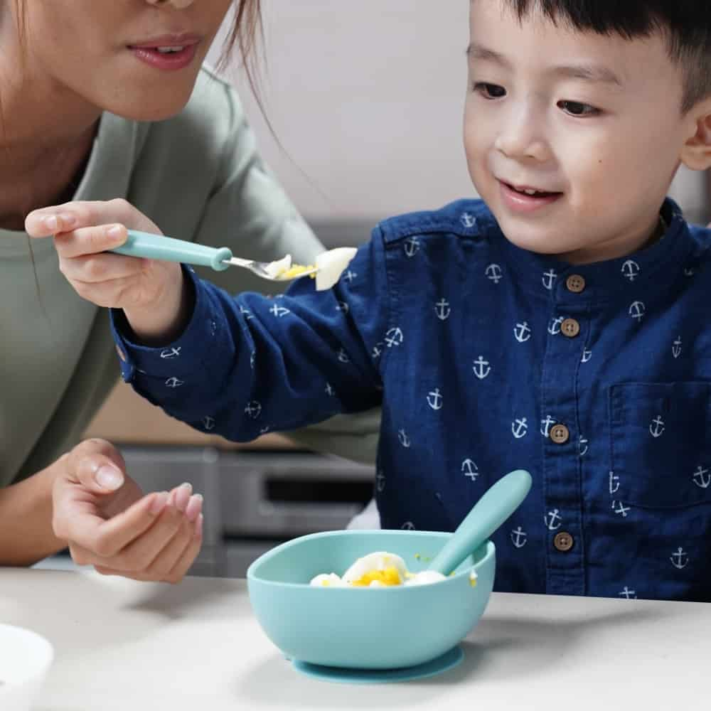 Boy Eating With Beaba Children's First Flatware Set
