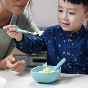 Boy Eating With Beaba Children's First Flatware Set