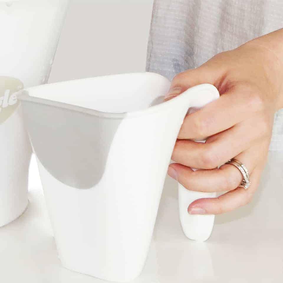 Mom holding Beaba by Shnuggle Washy Cup
