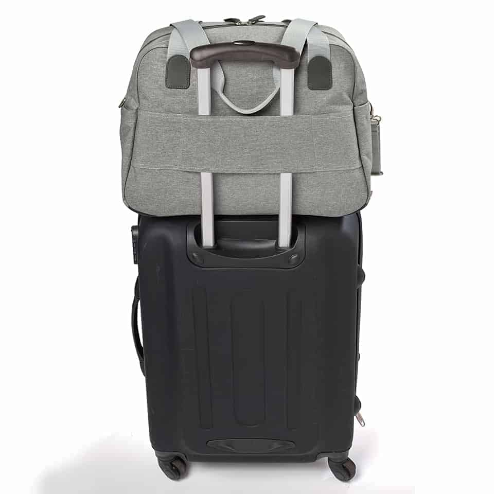 diaper bag sitting on top of luggage