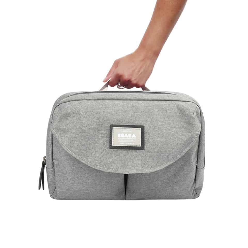 Hand holding diaper bag
