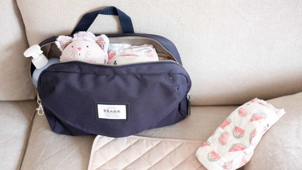 Beaba must have modern diaper bag holding toys and diapers