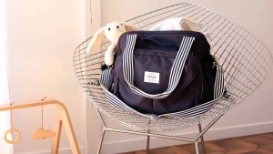 Beaba must have modern diaper bag on chair with rabbit inside