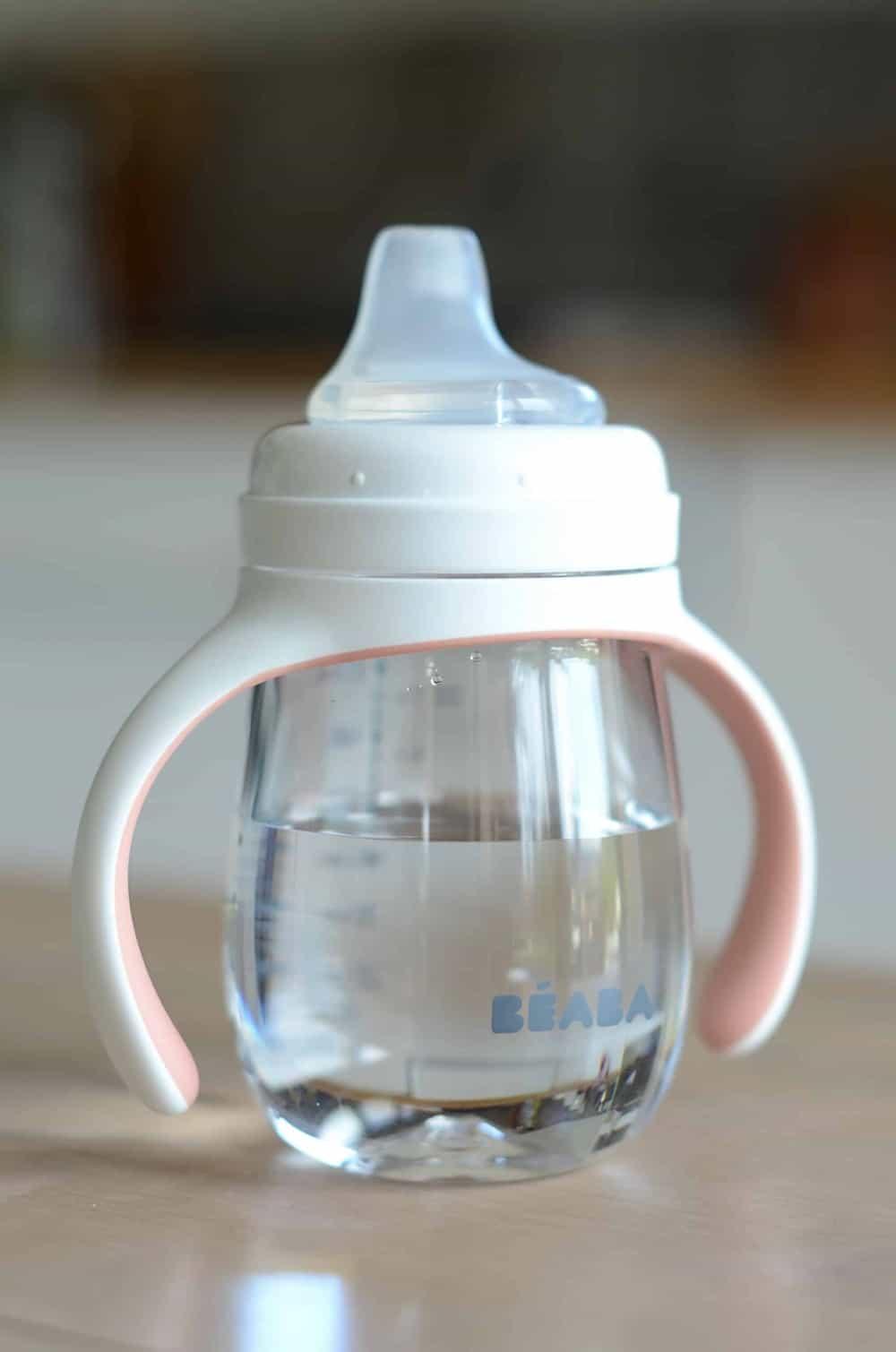 Beaba 2-in-1 Training Bottle Rose on counter