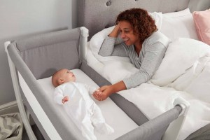 Mom playing with baby in BEABA by Shnuggle Air Cot Conversion Kit