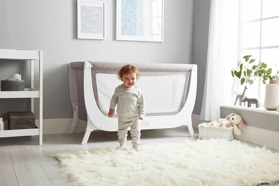 Baby Walking Next To Beaba by Shnuggle Full Size Air Crib