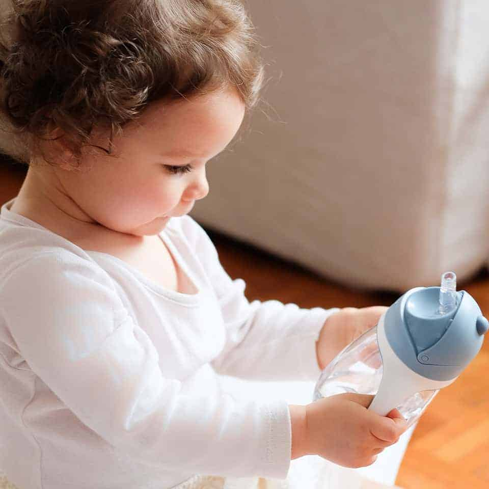 baby holding straw cup
