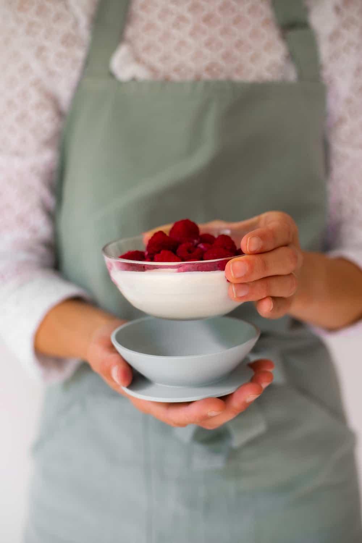Hand Holding Beaba 3-Piece Glass Suction Baby Feeding Set Bowl Rose
