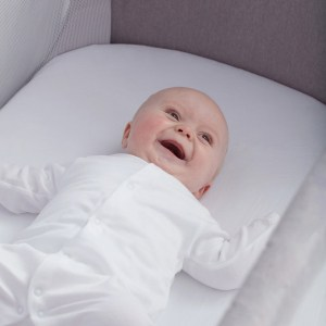 Baby laughing on Shnuggle Full Size Crib Air-Flow Mattress