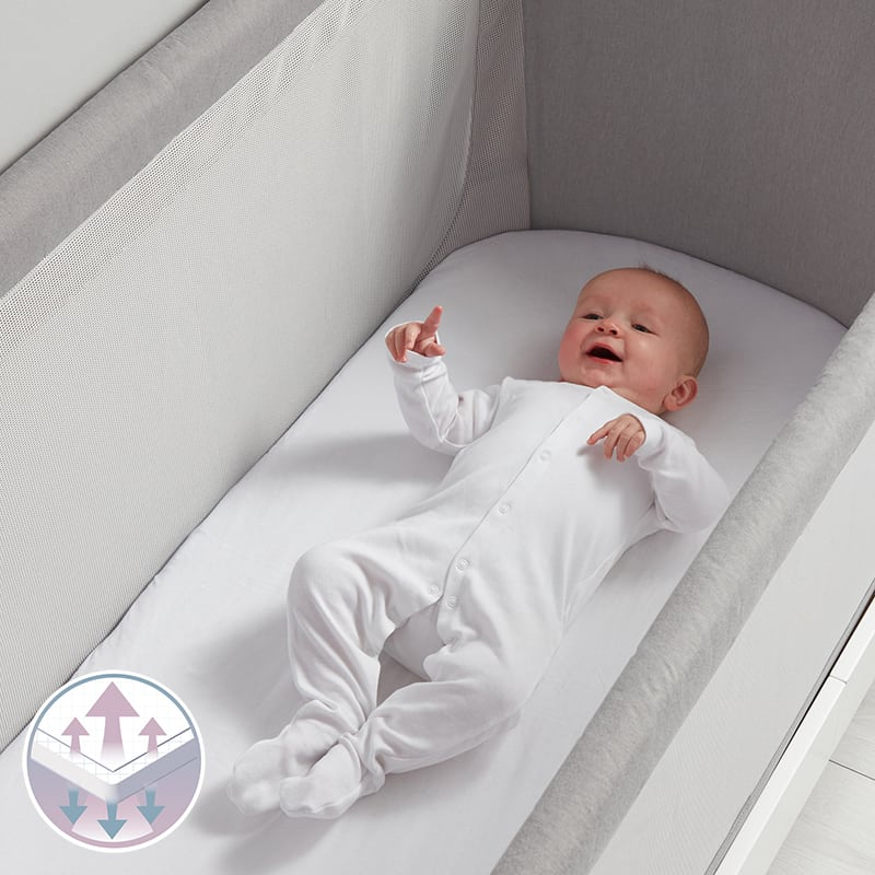 Baby in laying in Beaba by Shnuggle Air Cot