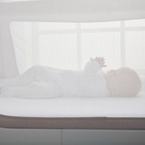 Baby in Beaba by Shnuggle Air Cot