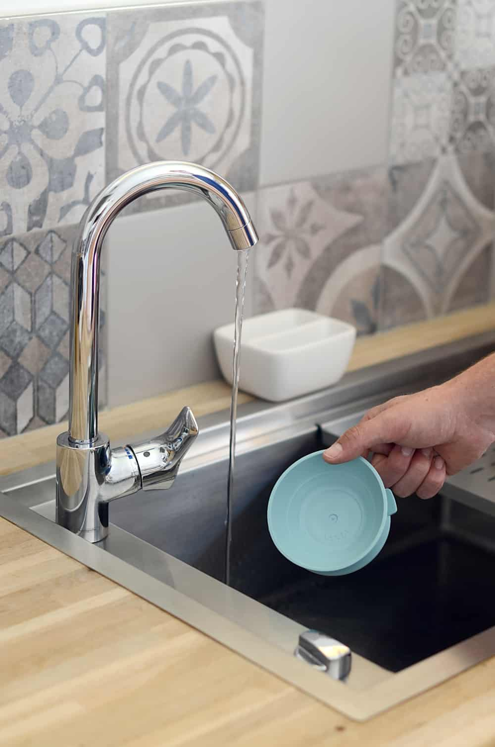 Beaba Glass Suction Silicone Piece Being Washed In Sink
