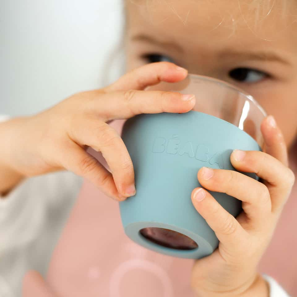 toddler drinking out of glass