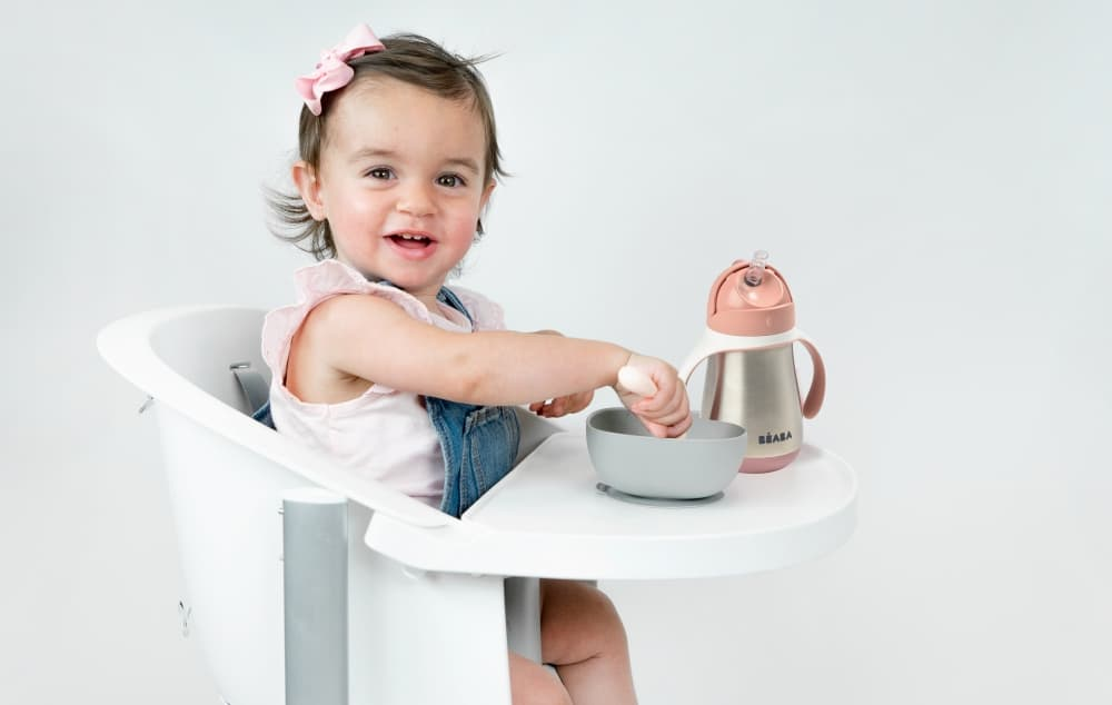 toddler with suction bowl and sip cup