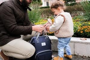 Dad Opening Wellington Backpack Diaper Bag Navy