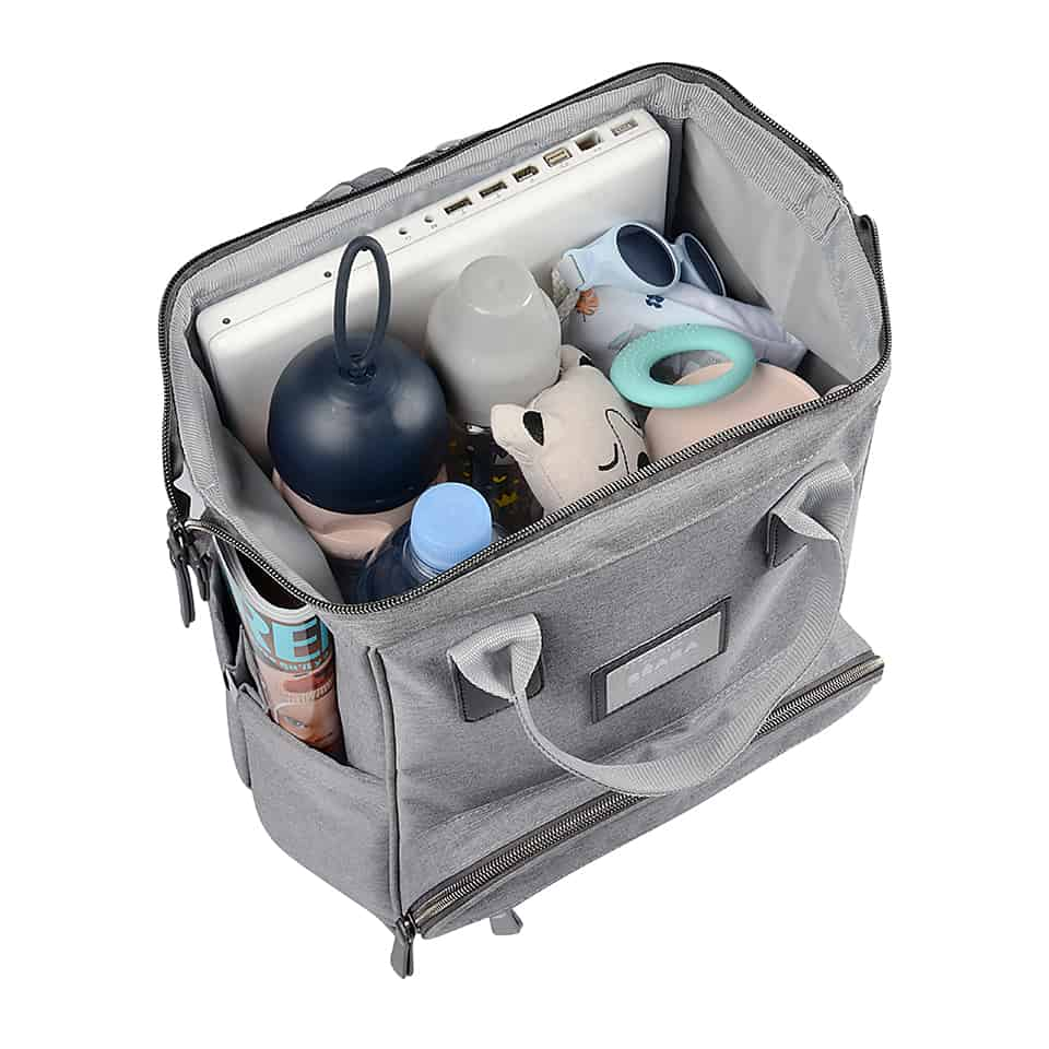 doctor opening with laptop, formula snack container, toys and clothes in bag
