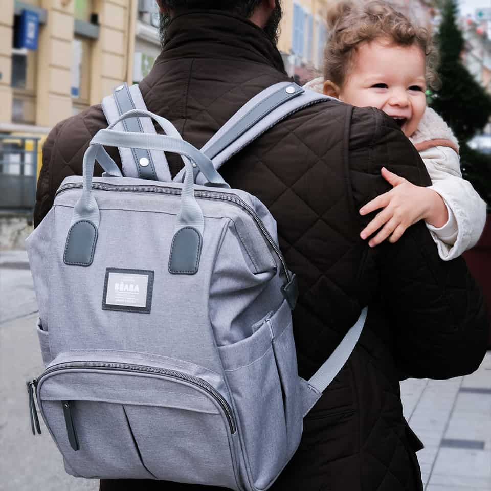 dad carrying baby while wearing wellington backpack