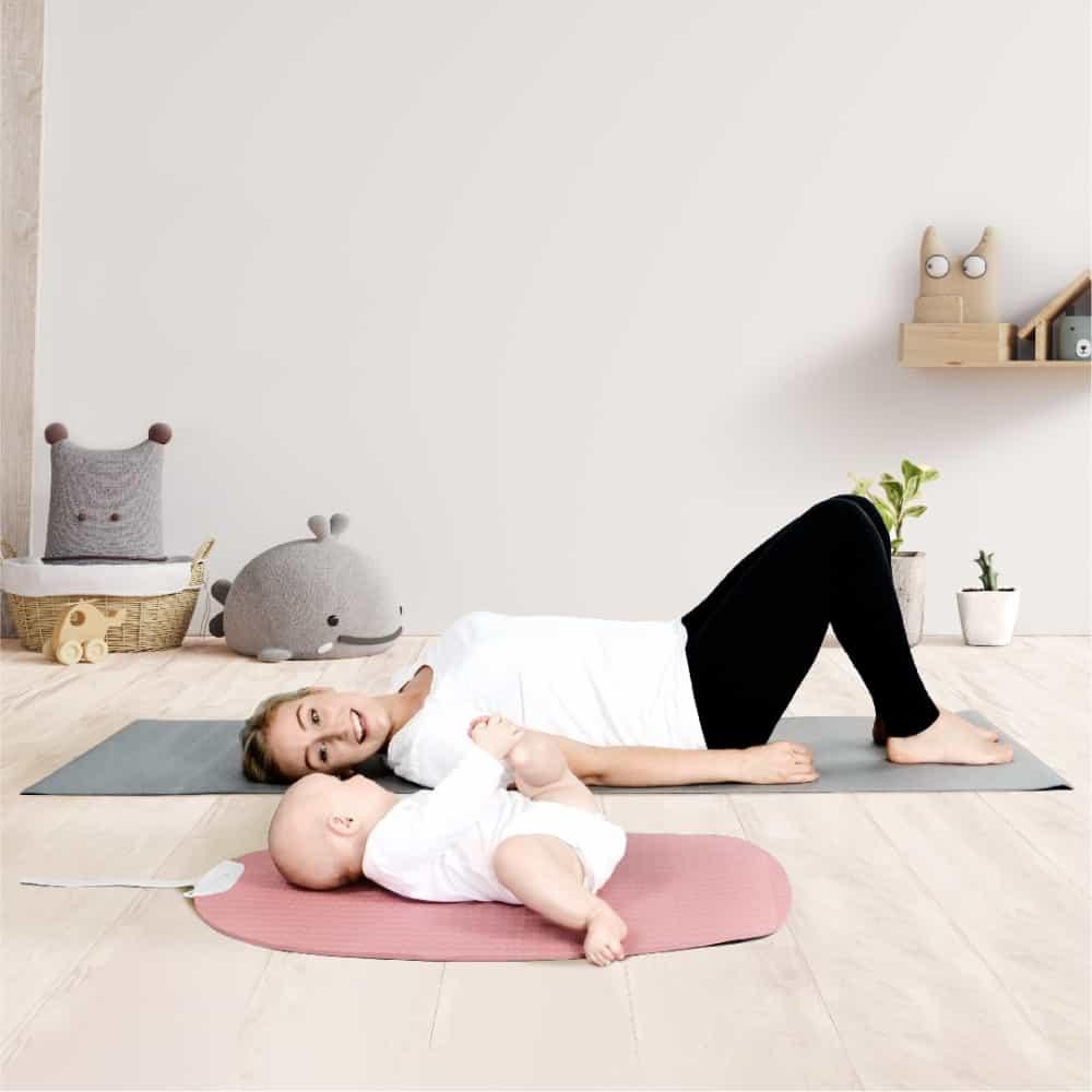 Mom and Baby doing yoga on mat